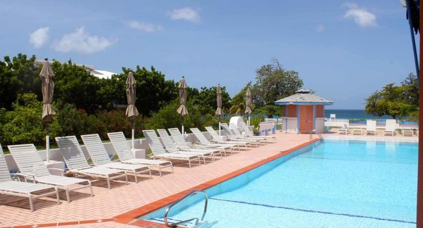 The pool area at Allamanda Beach Resort