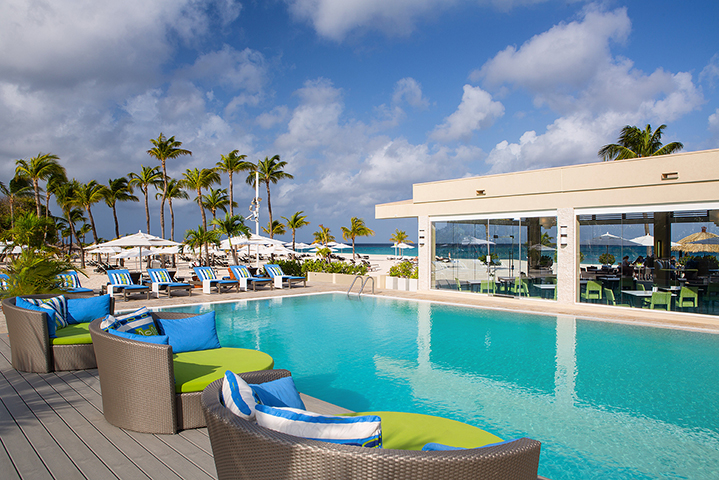 Bucuti's infinity pool is surrounded by large, plush sun beds and loungers.