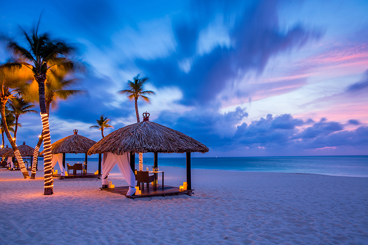 Arrange for romantic dining for two in a private palapa on the beach. Both sunset and moonlight seating are available.