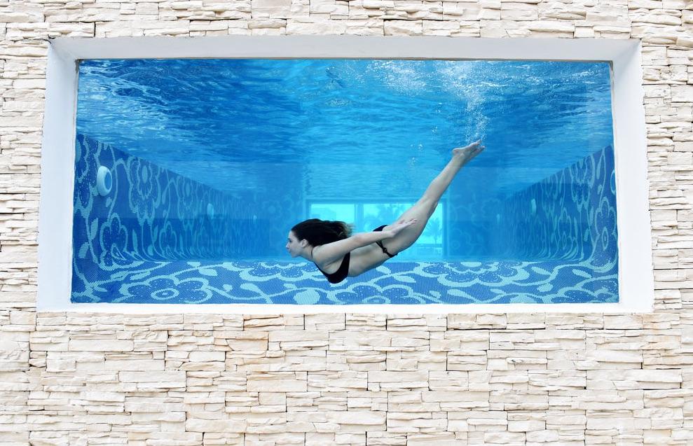 Take a selfie in the unique mermaid pool