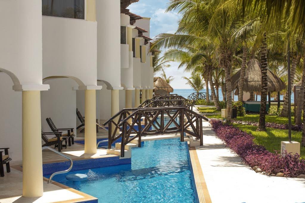 Swim-up suites at Hidden Beach Resort, a clothing-optional resort in Riviera Maya Mexico