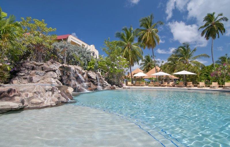 The freeform, 300-foot swimming pool at Radisson Grenada Beach Resort has two waterfalls