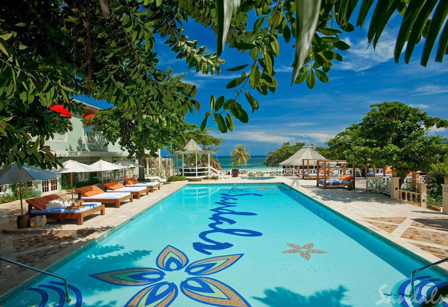 Poolside lounge beds at Sandals Montego Bay, Jamaica